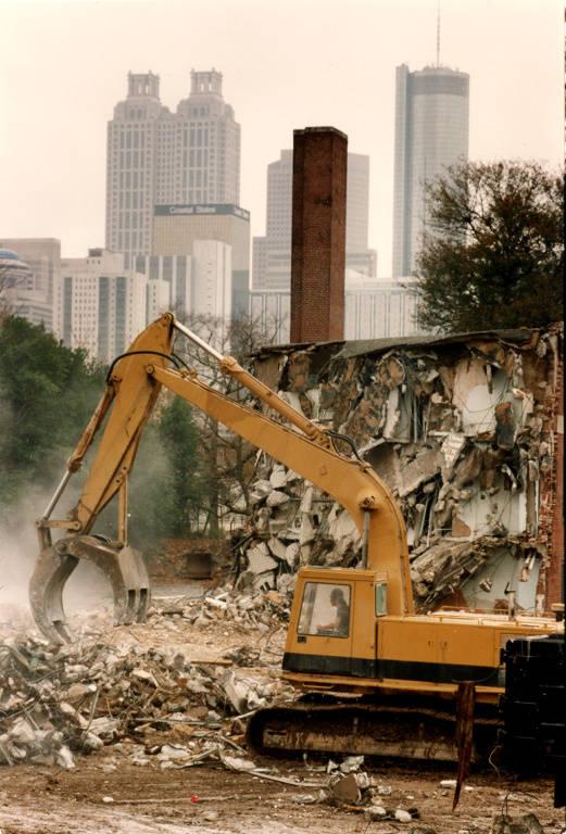 Excavator demolishing Techwood Homes in Atlanta in preparation for the olympic games