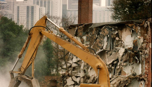 Excavator demolishing Techwood Homes in Atlanta in preparation for the olympic games